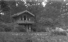 A photograph of the Swiss Chalet after it was re-erected in cobham Park
